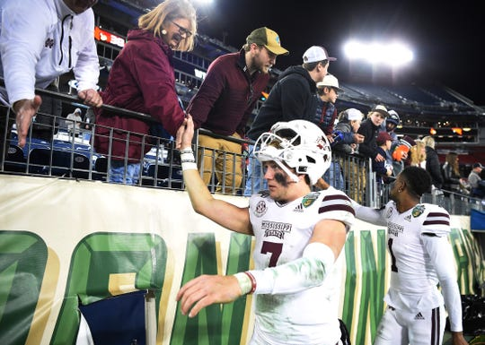Mississippi State quarterback Tommy Stevens (7) slaps hands with fans after the team's loss to Louisville in the Music City Bowl at Nissan Stadium in Nashville, Tenn., on Monday, Dec. 30, 2019.