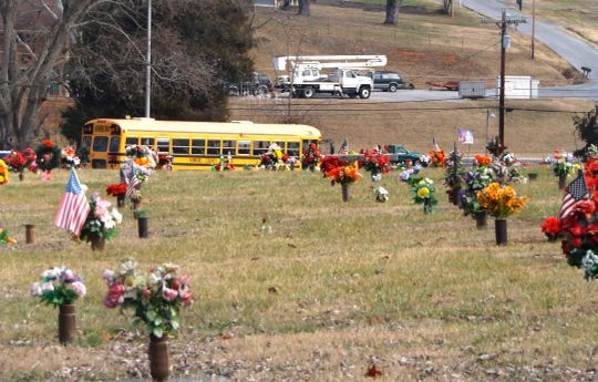 Hawkins County Schools Bus No. 89, the last one used by Rob Brooks in his 57 1/2-year career driving a school bus for the system, leaves the cemetery after his committal service in Church Hill, Tenn., on Dec. 28, 2019.