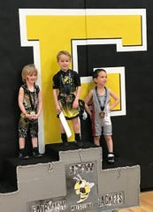 Luke Mitchell (1st) and Baxter Moore (2nd) with their first of many podium appearances as Jackets wrestlers at the annual Fairview Open youth wrestling tournament Saturday, Dec. 28, 2019.