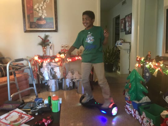 Dorian Pointer, 10, who attends activities at Franktown Open Hearts, spins on his hover board at his home in Franklin.