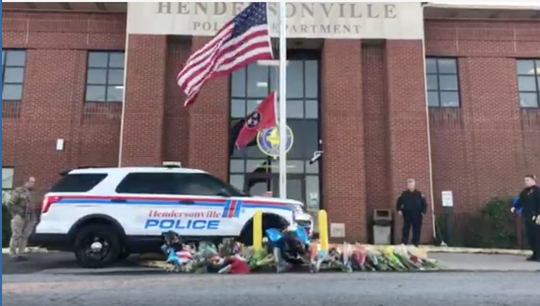 Hendersonville police move fallen Officer Spencer Bristol's car onto a memorial outside the police department.