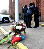 People console each other outside the Hendersonville Police Department on Tuesday, Dec. 31, 2019. Hendersonville police officer Spencer Bristol was killed in the line of duty after being struck by a vehicle during a foot pursuit across Interstate 65 on Monday, Dec 30, 2019.