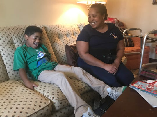 Dorian Pointer, 10, tells his mother Melora about his day at school at their home in Franklin. He said he's looking forward to activities at Franktown Open Hearts where he attends an after school program daily.