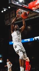 Vanderbilt center Ejike Obinna dunks the ball against Davidson at Memorial Gym on Dec. 30, 2019.