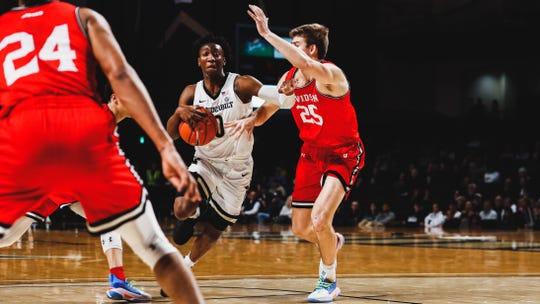 Vanderbilt guard Saben Lee (0) drives the ball against Davidson Bates Jones (25) at Memorial Gym on Dec. 30, 2019.