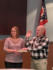 Scott Hite (right) is sworn in as Buckeye Lake's newest fire chief on Sunday, Dec. 29, 2019.