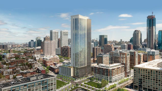 235 Grand towers over Downtown Jersey City, offering dramatic views of Manhattan and New York Harbor.