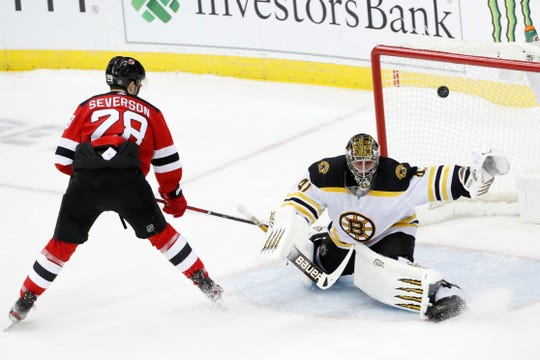 New Jersey Devils defenseman Damon Severson (28) gets his shot past Boston Bruins goaltender Jaroslav Halak (41) for a goal and the victory in a shootout in an NHL hockey game, Tuesday, Dec. 31, 2019, in Newark, N.J.