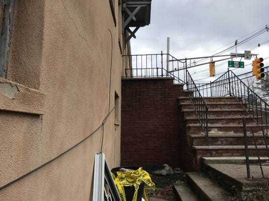 A bundle of yellow police tape in the trash at the apartment building on Wootton Street where the child died.