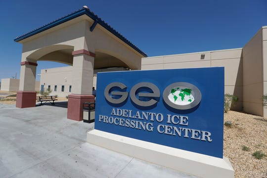 In this Aug. 28, 2019, file photo, the Adelanto U.S. Immigration and Enforcement Processing Center operated by GEO Group, Inc., a Florida-based company specializing in privatized corrections, is viewed in Adelanto, Calif. The Trump administration has awarded four contracts worth billions of dollars to operate private immigration detention centers in California, less than two weeks before a new state law forbidding them takes effect. (AP Photo/Chris Carlson, File)