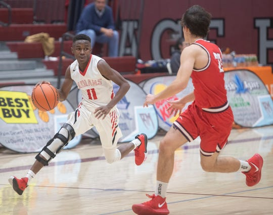 Adrian Bryant of Palm Springs High School drives the ball up court against Great Oak during the Rancho Mirage Holiday Invitational.
