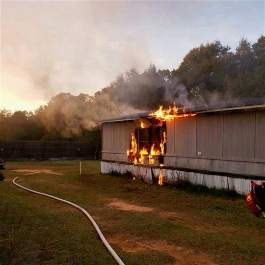Escambia County Fire Rescue units respond to a mobile home fire in the 8700 block of Rebel Acres Lane on Friday.