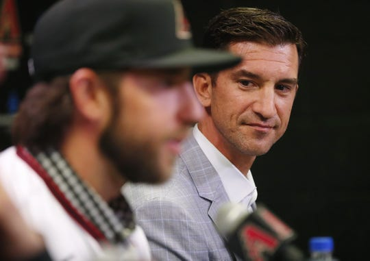 Madison Bumgarner answers questions as general manager Mike Hazen watches during a news conference at Chase Field December 17, 2019. Bumgarner signed a five-year deal with the Arizona Diamondbacks.