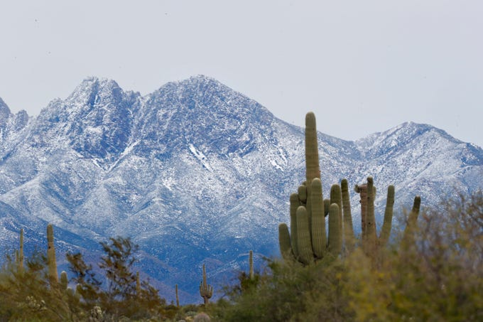 Snow adorns the top Four Peaks in Tonto National Forest near Fort McDowell on Dec. 30, 2019.