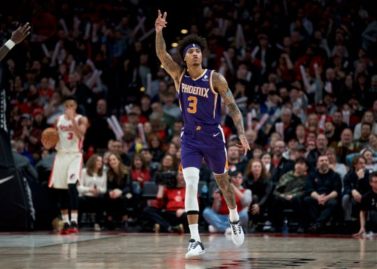 Phoenix Suns forward Kelly Oubre Jr. reacts after making a 3-point basket against the Portland Trail Blazers during the second half of an NBA basketball game in Portland, Ore., Monday, Dec. 30, 2019. The Suns won 122-116. (AP Photo/Craig Mitchelldyer)