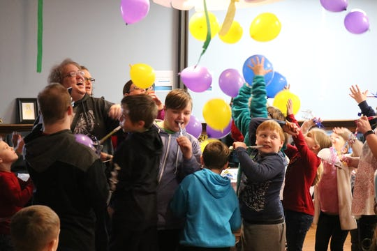 When the clock approached noon, everyone gathered together for a big countdown celebration with balloons falling from the ceiling.