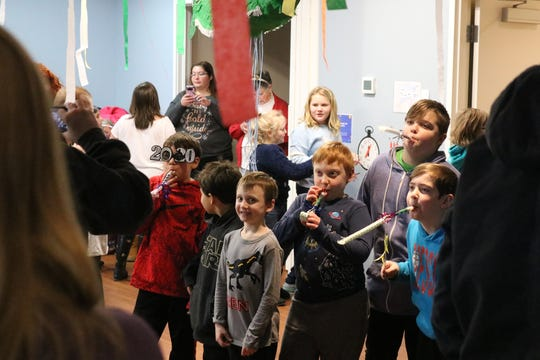 "Local children got the chance to celebrate the new year early at Ida Rupp's ""Noon Year's Eve"" celebration."