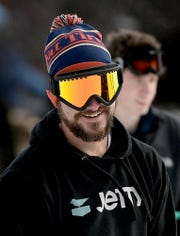 Justin Lyons of Lancaster chats with other snowboarders at the base of a trail at Roundtop Mountain Resort Tuesday, Dec. 31, 2019. The resort has 14 trails open and eight lifts operational in spite of warm winter weather. Bill Kalina photo