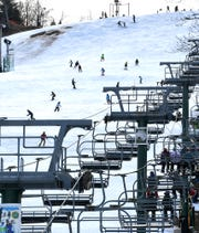 Skiers and snowboarders dot a trail at Roundtop Mountain Resort Tuesday, Dec. 31, 2019. The resort has 14 trails open and eight lifts operational in spite of warm winter weather. Bill Kalina photo