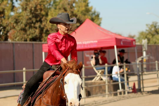 """Fresno State freshman Bailey Alexander rides atop of team horse """"Noodle"""" at the Fresno State Equestrian Center on Oct. 24, 2019"""