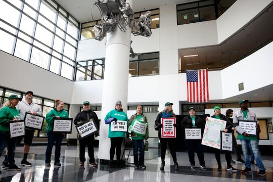 Members rally inside the Oregon Department of Human Services in Salem on Dec. 31, 2019. The Oregon AFSCME union has filed a grievance and several wage complaints alleging the state's Stabilization and Crisis Unit are owed back pay and job reclassification to employees.