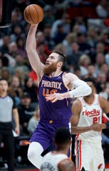 Phoenix Suns center Aron Baynes shoots against the Portland Trail Blazers during the second half of an NBA basketball game in Portland, Ore., Monday, Dec. 30, 2019.