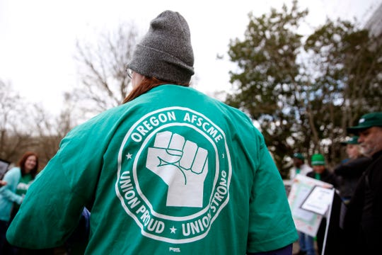 Darlene Carter and others rally outside the Oregon Department of Human Services in Salem on Dec. 31, 2019. The Oregon AFSCME union has filed a grievance and several wage complaints alleging the state's Stabilization and Crisis Unit are owed back pay and job reclassification to employees.