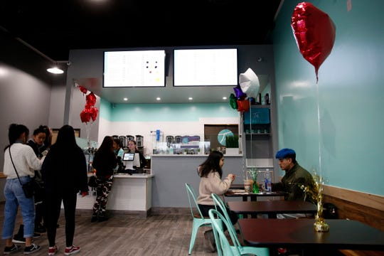 People order and sit inside T4 Tea House in Keizer on Dec. 30, 2019.