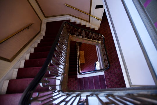 Among the renovations at The Strand Theatre of Louisiana are the faded carpets on the stairs.