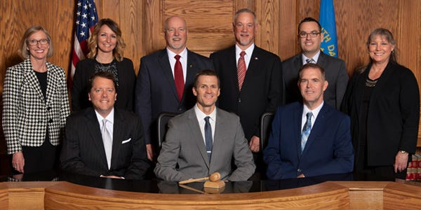 Sioux Falls City Councilors and Mayor Paul TenHaken pose for a photograph at Carnegie Town Hall.
