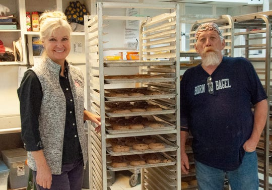 Debra Jensen, owner of Black Hills Bagels in Rapid City, stands next to a rack of hand-formed bagels with baker Michael Regan. Jensen said she and her husband, Jack, make an effort to connect with employees and customers in ways that chain stores cannot.