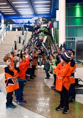 Youth hockey players form a tunnel over the escalator to send off Ryker Hovey on his Make A Wish trip to meet his favorite hockey player, Bruins goalie Tuukka Rask, on Tuesday, Dec. 31, at the Sioux Falls Regional Airport.