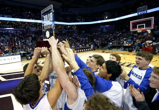 The Hartville Eagles hoist the Blue Division championship trophy after beating the Logan-Rogersville Wildcats to claim the Blue Division championship during the Blue and Gold Tournament at JQH Arena on Monday, Dec. 30, 2019.