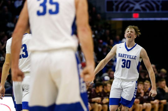 Hartville's Brady Ward celebrates a basket putting the Eagles up 10-points on the Logan-Rogersville Wildcats in the Blue Division championship game during the Blue and Gold Tournament at JQH Arena on Monday, Dec. 30, 2019.