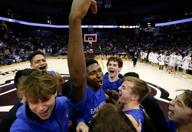 Greenwood's Aminu Mohammed is swarmed by teammates after he led the Bluejays to the Gold Division championship in the Blue and Gold Tournament on Monday, Dec. 30, 2019.