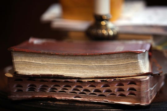Ruth Rodgers' well-worn Bibles from daily reading at her home in Rogersville on Dece. 30, 2019.