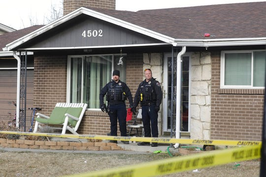 West Valley City policemen stands in front of a home Tuesday, Dec. 31, 2019, in West Valley City, Utah. A Utah mother is suspected of killing her 4-year-old daughter, The woman knocked on her neighbor's door in a Salt Lake City suburb early Tuesday morning and told them she had killed her daughter, West Valley City police said in a news release. Officers went to the house and found the woman waiting on the porch and the dead child in the basement of her home. (AP Photo/Rick Bowmer)