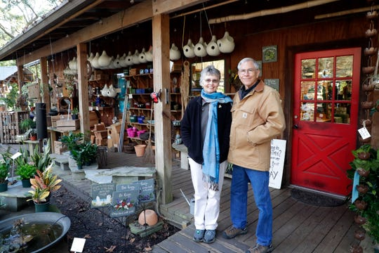 Donna Legare and Jody Walthall, the founders of Native Nurseries, pose for a photo outside the storefront of the nursery on Tuesday, Dec. 31, 2019..
