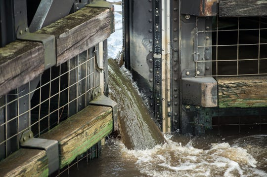 Water with traces of algae flows through at the St. Lucie Lock and Dam on Friday, June 29, 2018, as discharges from Lake Okeechobee were scheduled to come to a stop.
