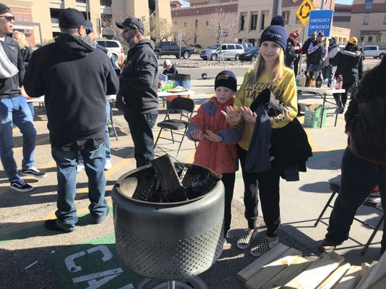 Siblings Tayvian and Shaylee Neill tried to stay warm Tuesday morning at their University of Texas at El Paso tailgate.
