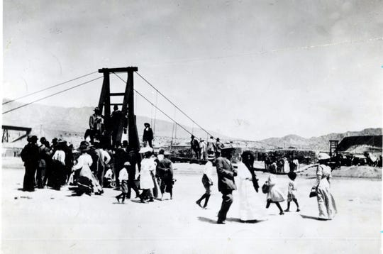 "May 1911: Cable Bridge over Rio Grande. ""Swinging Bridge"" across the Rio Grande, between the El Paso Smelter and U.S. Mexico Boundary Monument No. 1. A pass was needed for crossing. It had to be obtained from Brick Yard proprietors, who owned bridge."