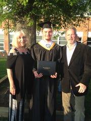 Ben Esenten at his high school graduation with parents Mary Thornton and Tom Esensten.