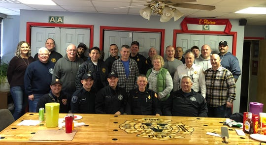 Vineland Fire Captain David Bell, second from right in front row, celebrated his retirement Dec. 31, 2019 with his family and fellow firefighters.