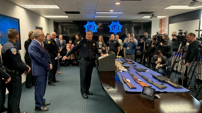 Fresno Police Chief Andrew Hall announces the arrest of six gang members in connection to a November mass shooting that killed four at a New Year's Eve press conference.