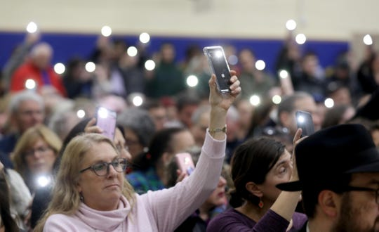 Lights from cell phones are held aloft by the hundreds who attended a vigil at the Jewish Community Campus in West Nyack Dec. 30, 2019. The vigil, sponsored by the Jewish Federation and Foundation of Rockland County was held as a show of solidarity after the stabbing of five Hasidic Jews attending a Hanukkah celebration in Monsey Saturday night.