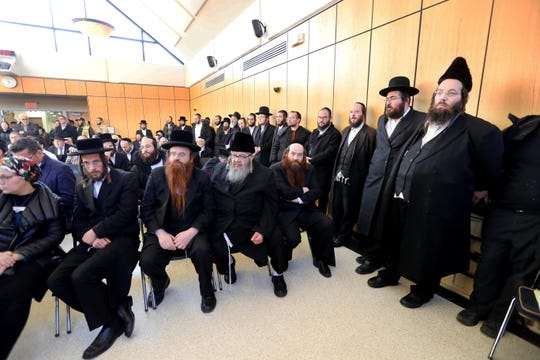 Members of the Monsey Hasidic community attended a news conference at Ramapo Town Hall Dec. 31, 2019.