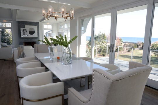 The dining room with a view in a waterfront new construction on Pine Island in Rye Dec. 20, 2019.