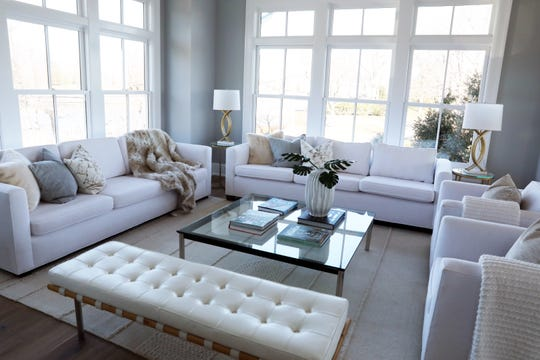 The living room in a four-bedroom waterfront new construction on Pine Island in Rye Dec. 20, 2019.