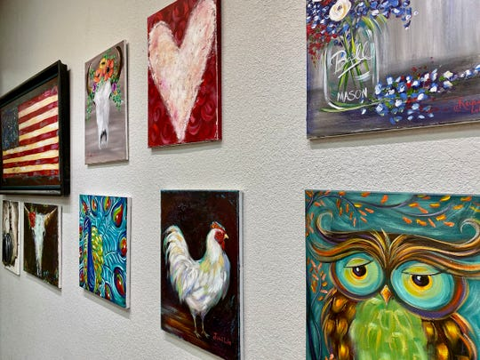 (Richard Carter) The walls of Rachel Liles' How Great Thou Art studio features many of her paintings  from over the years.
