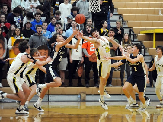 Players from Granville and host Tri-Valley fight for a rebound on Monday night in Dresden. The Scotties won, 62-42.